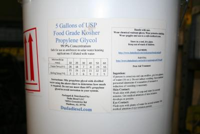 Propylene Glycol: View of label of propylene glycol with ingestion, skin contact and eye contact information. This also shows the the mixing chart.  Propylene Glycol has many uses besides solar heat transfer loops.      * Solvent in the flavor concentrate and fragrance industry, an excipient in elixirs and pharmaceuticals, and a coupling agent in sunscreens, shampoos, shaving creams and other personal care products     * Wetting agent for natural gums to simplify compounding     * Humectant, preservative and stabilizer in diverse applications.     * Raw material to produce high-performance unsaturated polyester resins (UPR) used for marine construction, gel coats, sheet molding compounds and synthetic marble castings     * Chemical intermediate in the production of resins for paints and varnishes     * Solutions with water to make antifreeze, heat-transfer fluids and aircraft and runway deicing fluids     * Solvent in printing inks     * Solvent and enzyme stabilizer in laundry detergents     * Stabilizer in hydraulic fluids     * Plasticizers to improve the process-ability of plastics Propylene glycol is safer in two ways than ethylene glycol, the alcohol used in car antifreeze. One, it will not kill pets if they drink some that is spilled and two, it decomposes when it seeps into the ground or ground water faster than ethylene glycol.